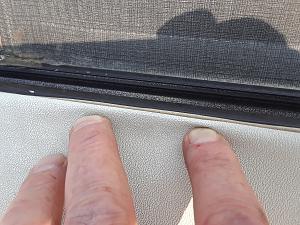 photo of roof membrane on top of metal siding edge.jpg