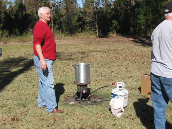 Getting the cooking oil hot to fry the turkey.