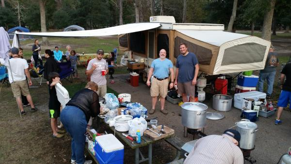 Warm temps have us smiling as the turkey gumbo cooks Friday after Thanksgiving.