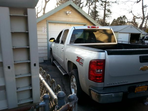 Barely fits in drive, no way she's getting in garage.
