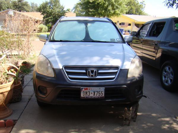 Old nasty looking headlights on 2005 Honda CRV.
