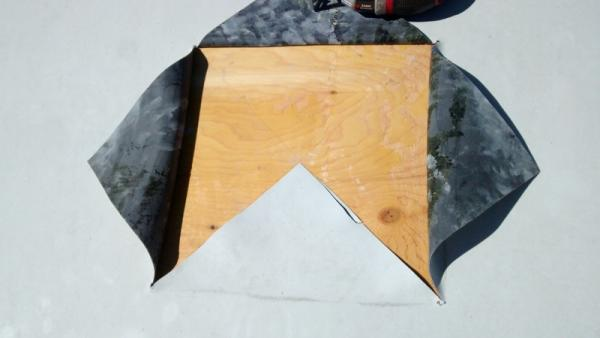 Cut EPDM roofing material.
