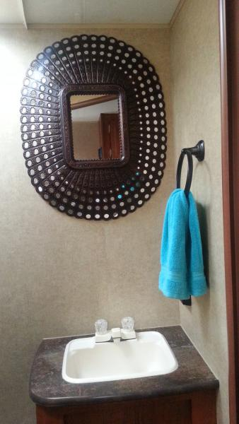 Bathroom mod; removed the ugly fake oak-framed mirror, added this lightweight tin mirror and residential hand towel rack