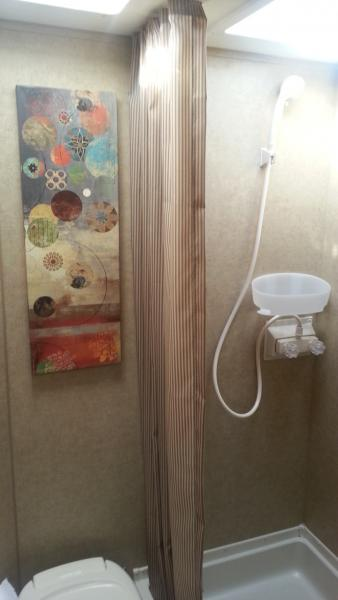 "Bathroom ""Command Strips"" shower caddy with art, attached using Command Strips"