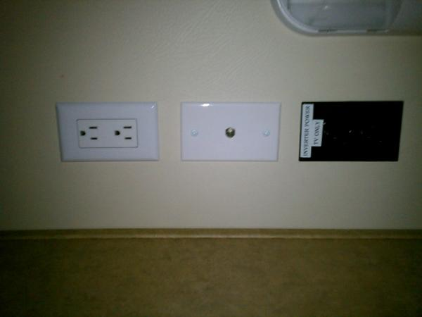 View of the factory outlets and the black outlet powered from the invertor without TV mounted.