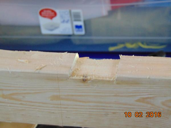 Hard to believe that thin piece of plywood would be warped. No problem, chizeled out a groove for the center support