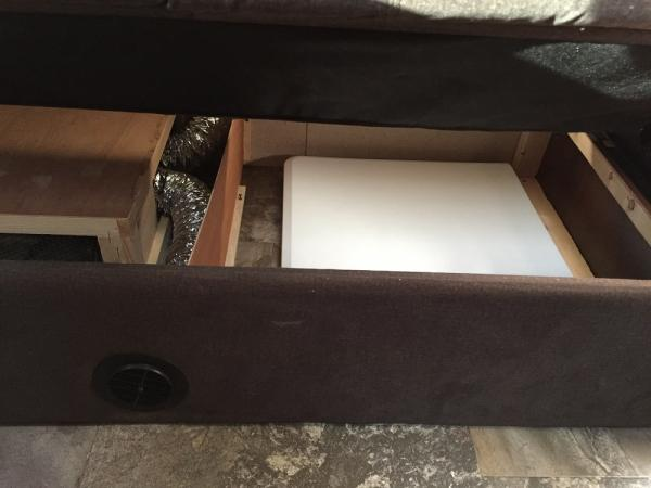 """This wasn't anything major but it really added much needed space. We moved the center divider under the couch about 5"""" closer to the ducting so we could store our fold up table under there."""