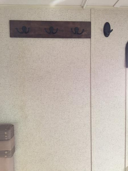 Added coat hooks to the left of the door.
