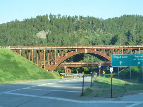 East gateway into Custer State Park and passes through parts of Black Hills National Forest and Mt. Rushmore National Monument.  One of many wooden bridges along the Peter Norbeck Scenic Byway.  An absolute MUST SEE if you ever find yourself near Mount Rushmore.  WARNING...NOT for long rigs.  We did this in our Yukon XL pulling our Jayco 26BHS (29 feet), we navigated the road well enough.  Very winding, I would not take a 5th wheel on this path.  That said, you are missing an incredible site if you don't tour this road when in the area.
