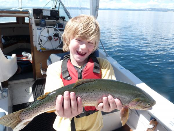 My son expressing how fun catch & release can be of native cutthroat trout on Yellowstone Lake.  We had a really fun day!