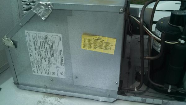 Remove the A/C plastic cover and on the left side there is a access panel that removes with two screws.
