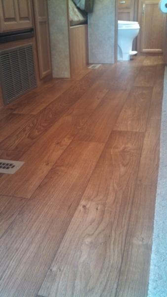 We picked a fiberglass backed vinyl in a wood grain.   We love the upgraded look.