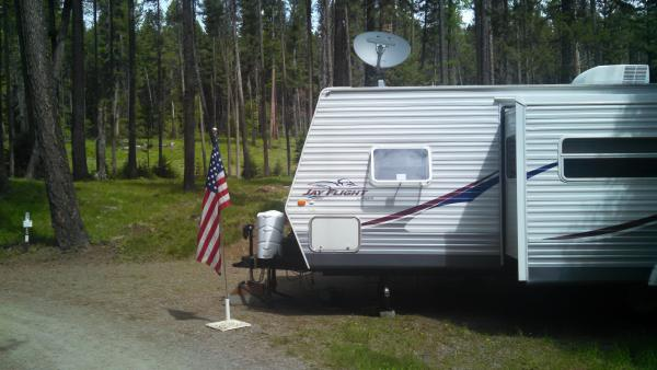 Memorial Day weekend 2014.  If we nudge the tongue close enough to the CG road, Directv will dial right in.  There is about an 8 foot window the pine tree canopy that will give us at least some partial satellite coverage.  We get the news.  If Yellowstone blows we'll know to stay put or head North West fast!!