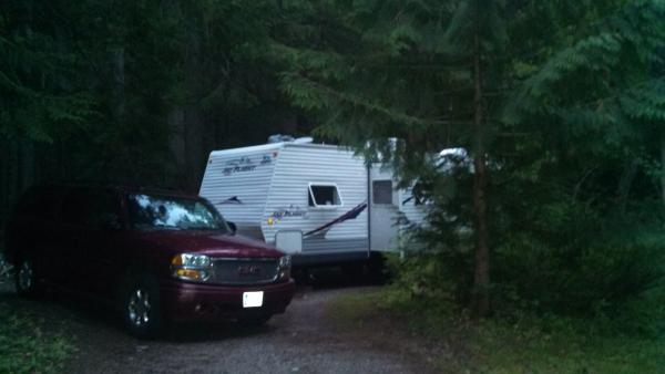 Avalanche Creek campground.  Nestled in a corner site and surrounded by cedar trees.  On a hot summer stays, this is a preferred spot.  It can be 90-100 in the park and a solid 15-20 degrees cooler in this forested CG.