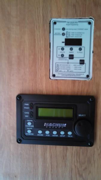 These are my battery monitor on top and my inverter/charger remote on the bottom.  I decided to locate these in the wall of my entertainment center, the wall you pass in route to the bedroom of our Jayco 26 BHS.  Easy access and I can view them from the kitchen or even from outside when looking in the main cabin door.  See my pictures from the album on my battery monitor installation to get a better orientation of where these are specifically located.