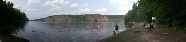 Panoramic view of Mazinaw Lake and Mazinaw Rock in the background.
