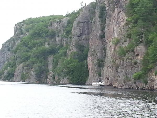 A view of the Pontoon boat tour alongside Mazinaw Rock.  Puts things in perspective.