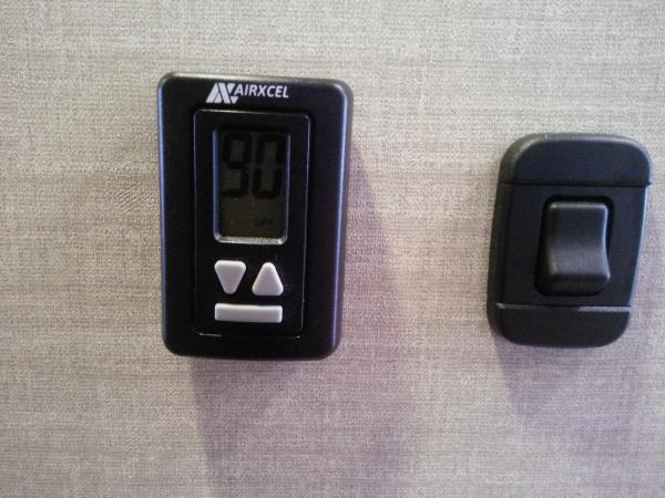New thermostat design. Bottom button lights up large display.
