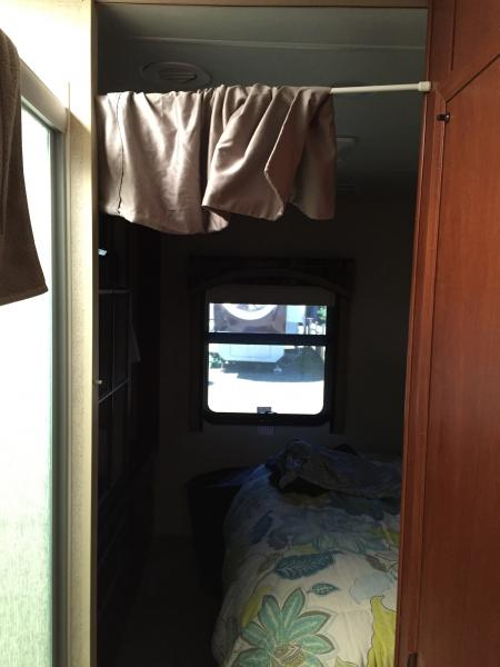 Quick way to block sun from bathroom skylight  Into bedroom.   Spring bar and sheet