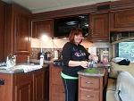 Wendy cooking something delicious in beautiful kitchen