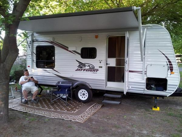 Our setup. I didn't realize I was close to the tree to open the awning all the way until after I uncouple the truck.