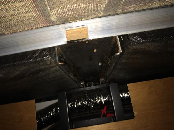 Looking up under the slide the open end of the channel is where the drive unit was welded to the slide.