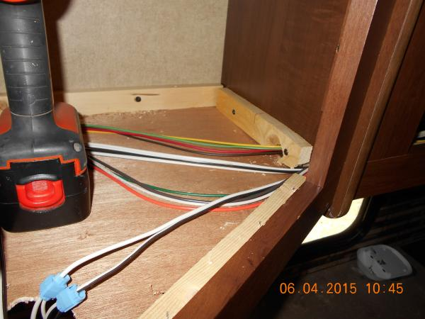 Adding Outlets cabinet bottom