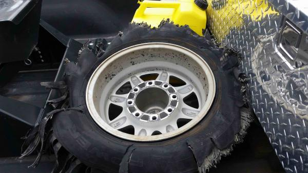Shredded tire in truck bed.