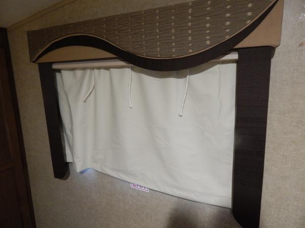 Black out curtain in bedroom, original shade is up.