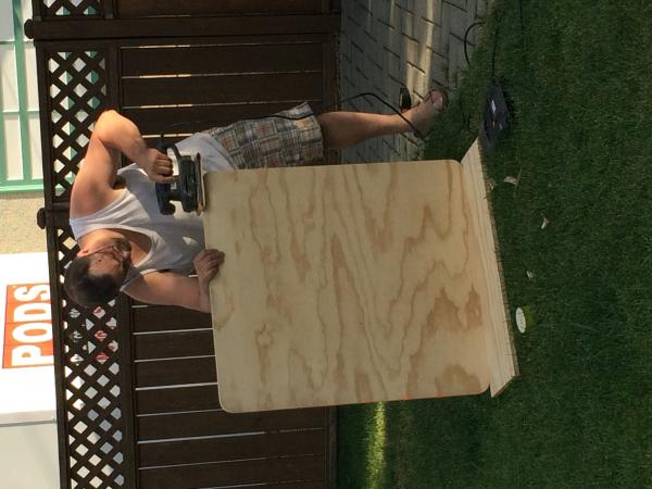 "Here's hubby making our new dinette table out of 3/4"" plywood.  The dimensions are 32""x36"".  There is another 3/4"" plywood piece that will stay flat all the time that is 16""x32"".  More pics to come on this mod later in the week."