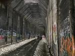 """A bit blurry but you can see where the old """"cut"""" was inside the tunnel. The walls are peppered with graffiti, some of it is true art, others are just..."""