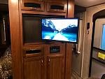 """I installed an articulating mount inside Jayco's """"lazy Susan"""" swiveling TV cabinet. Now we can actually watch TV from the sofa."""