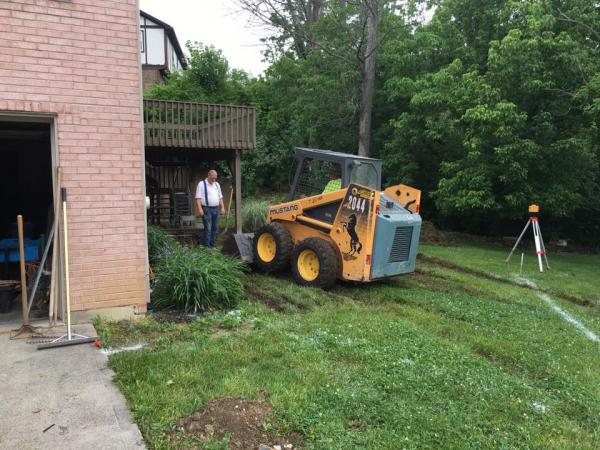 Rented bobcat to dig out the slab.