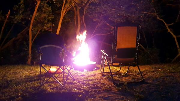 Ahhhhh. Nothing beats a campfire. The waters edge is just beyond the trees. Great campsite!